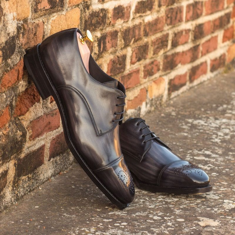 Custom Made Goodyear Welt Derby in Italian Raw Crust Leather with Grey Hand Patina Finish, Featuring Beveled Waist Sole and Metal Toe Taps